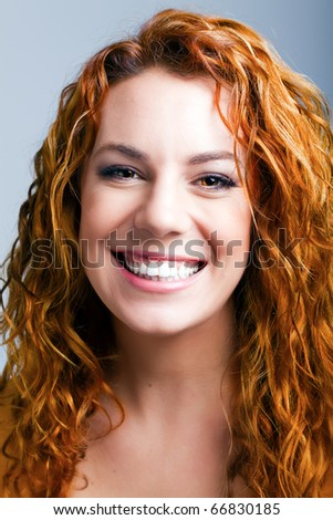 young colorful redheaded caucasian girl - studio shot on grey
