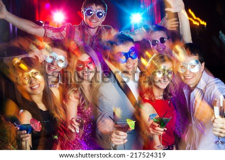 young company celebrates birthday with a cocktail in hand - stock photo