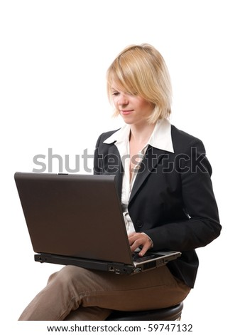 Young concentrated businesswoman typing on laptop - stock photo