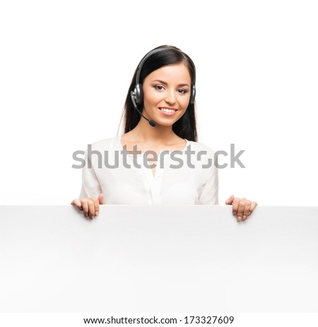 Young, confident and beautiful customer support operator with the blank billboard isolated on white - stock photo