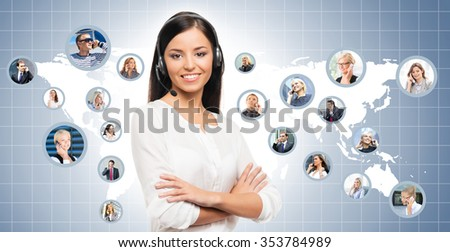 Young, confident and beautiful customer support operator working in a call center. World map on a background.  International call center concept. - stock photo