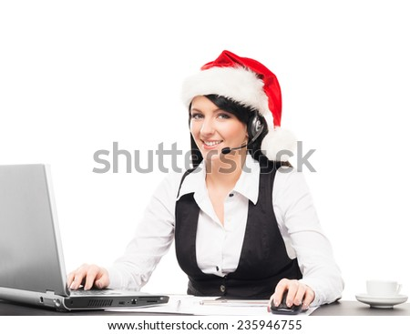 Young, confident and beautiful support operator in Christmas hat working in a call center  - stock photo