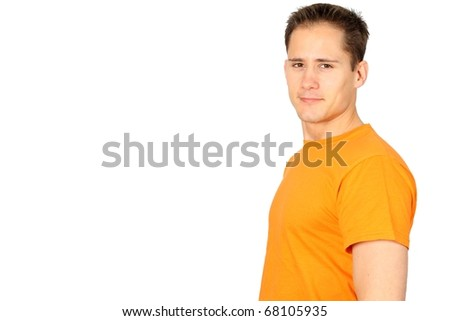 Young confident and happy man in an orange T-shirt - stock photo