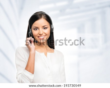 Young, confident and smiling customer support operator working in office - stock photo