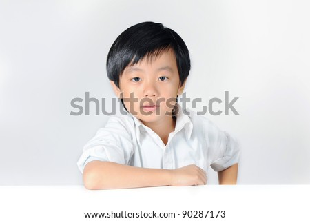 Young confident boy in white shirt - stock photo