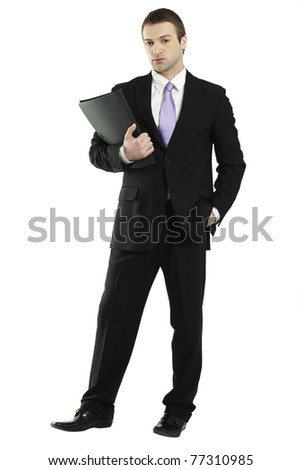 young confident businessman holding black portfolio - stock photo