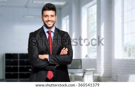 Young confident businessman portrait - stock photo