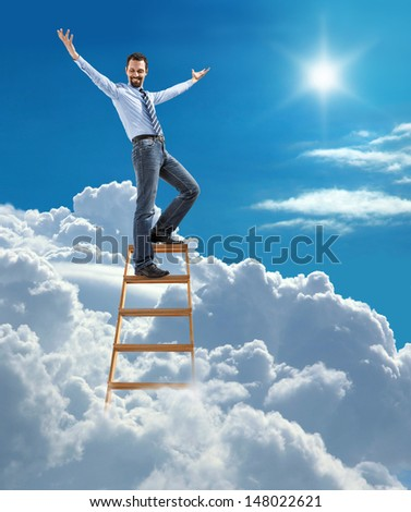 young confident businessman standing at the ladder high in the sky spread his arms / young man in shirt and tie set up the arms to the side as the winner on top of the ladder on heaven - stock photo
