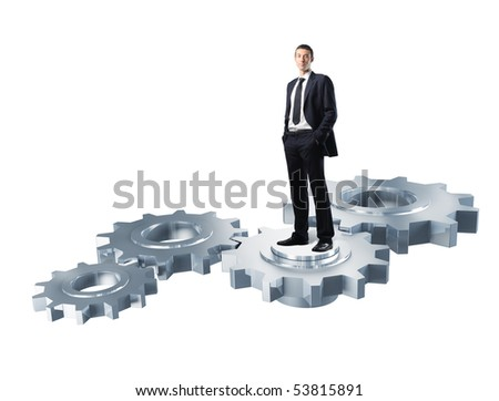 young confident businessman standing on metal gear isolated on white
