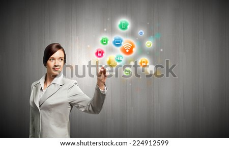 Young confident businesswoman and colorful media icons - stock photo