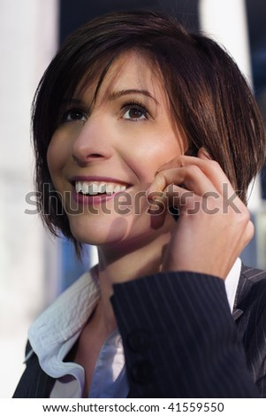 Young confident female professional talking on mobile phone