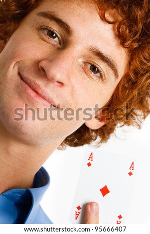 Young confident man showing an ace