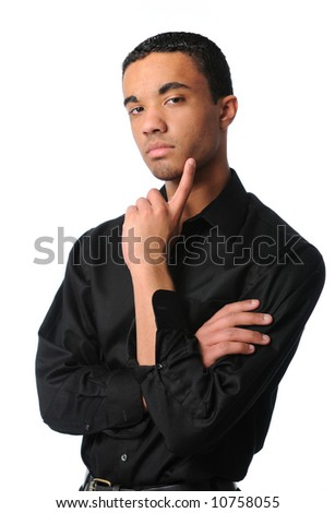Young confident man standing and thinking - stock photo