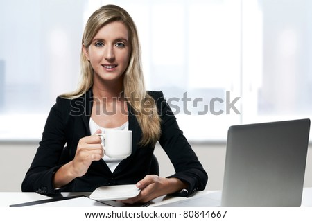 young confident smiling successful business woman working at office - stock photo