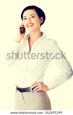 Young, confident, successful and beautiful businesswoman with the mobile phone. - stock photo