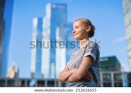 Young confident woman in business district of Paris - stock photo