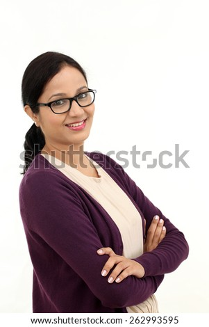 Young confident woman with arms crossed against white - stock photo