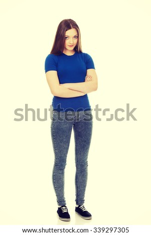 Young confident woman with crossed arms. - stock photo