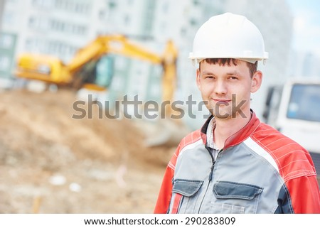 young construction site manager worker at building area - stock photo