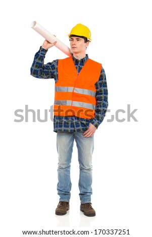 Young construction worker holds paper roll on his shoulder. Full length studio shot isolated on white.