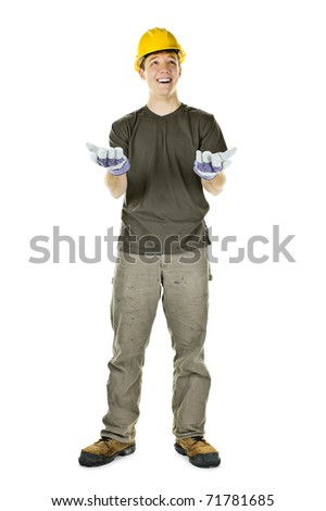 Young construction worker looking up shrugging isolated on white background - stock photo