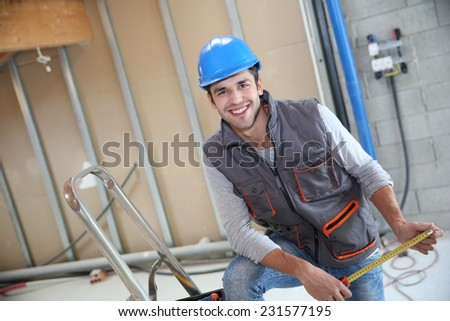 Young construction worker on site - stock photo
