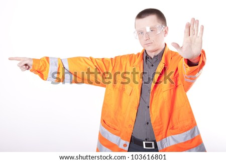 Young construction worker pointing right.