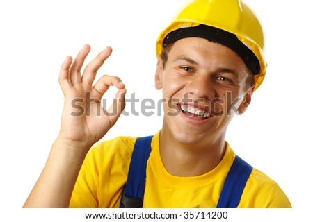 Young construction worker showing OK hand sign, isolated over white - stock photo