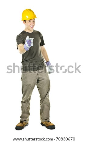 Young construction worker with hard hat pointing isolated on white background - stock photo