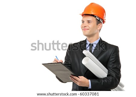 Young construction worker with helmet writing down notes isolated on white background - stock photo