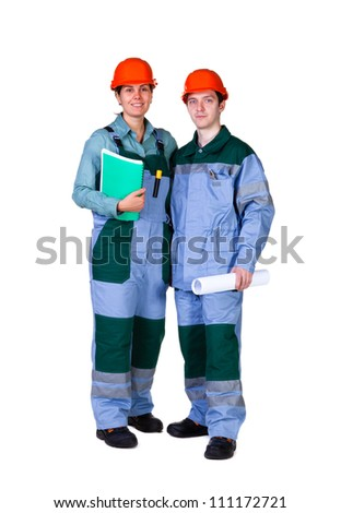 Young construction workers isolated on white background - stock photo