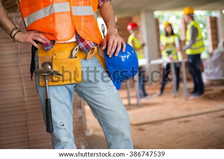 Young construction workman communicate with walkie talkie - stock photo