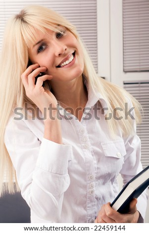 young consultant speaking on mobile phone - stock photo