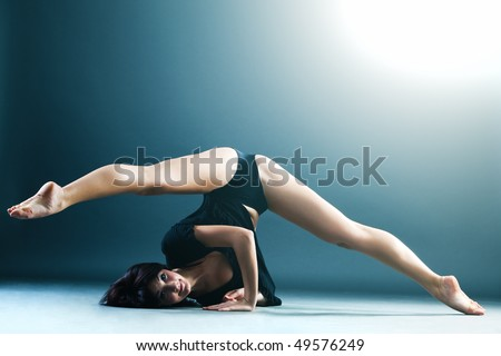Young contemporary female dancer doing splits in the air