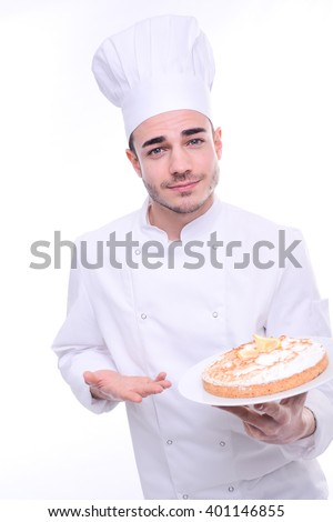 young cook pastry chef isolated on white background holding proudly cheesecake pie