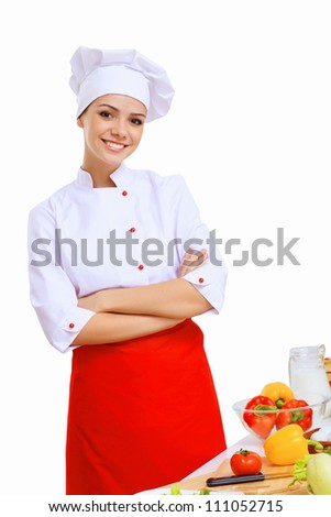 Young cook preparing food from fresh vegetables - stock photo