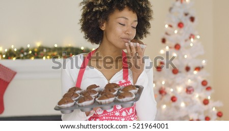 Young cook sampling a fresh Christmas cookie