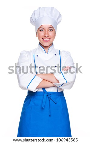 young cook standing with hands folded and smiling on white background - stock photo