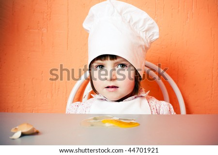 young cook with broken egg - stock photo