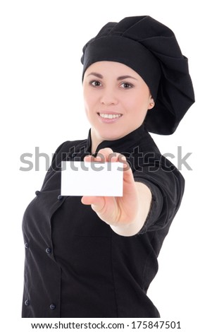 young cook woman in black uniform showing visiting card isolated on white background - stock photo