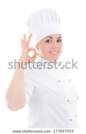 young cook woman in uniform showing ok sign isolated on white background