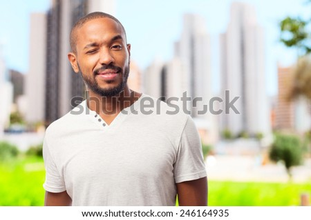 young cool black man wink sign - stock photo