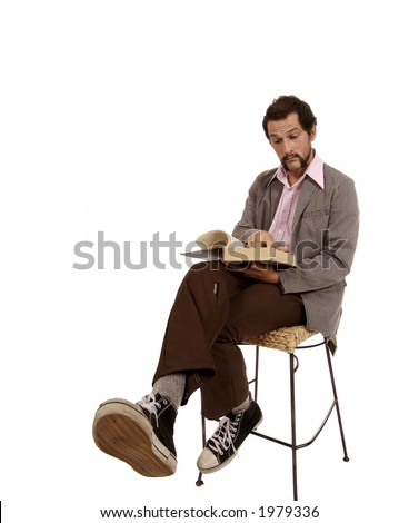 Young Cool Hip Retro Stylish Guy with fun expression on face while reading a dictionary - stock photo