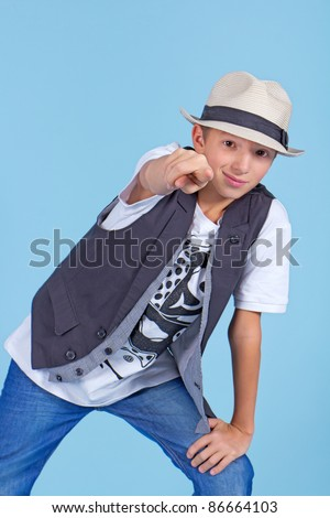 Young cool looking man pointing to the viewer - stock photo