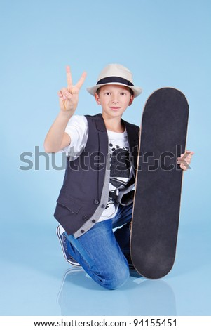 Young cool looking man with skateboard - stock photo