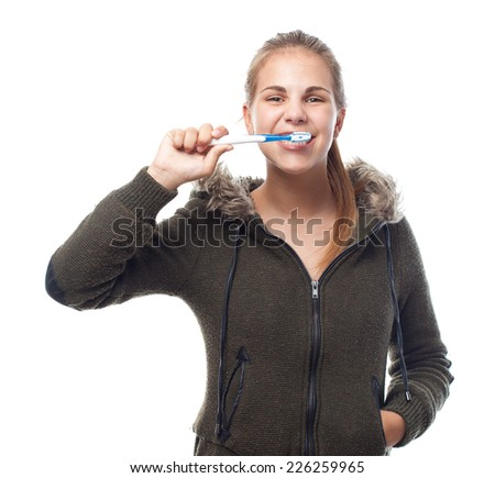 young cool woman brushing her teeth - stock photo