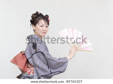 Young cool woman in a kimono - stock photo