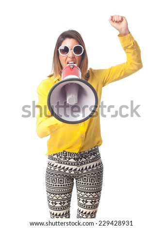young cool woman shouting on megaphone - stock photo