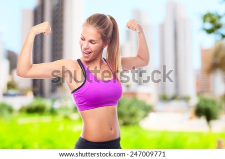 young cool woman strong gesture - stock photo