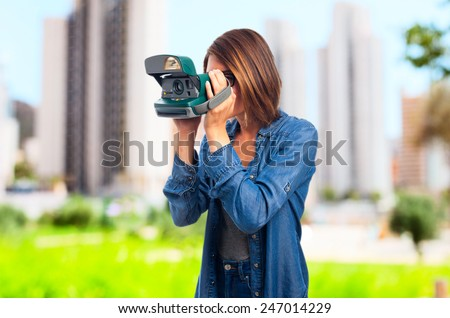 young cool woman with a camera - stock photo